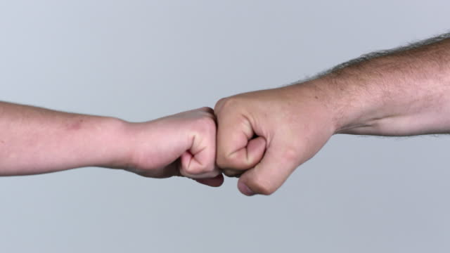 Man and woman fist bumping