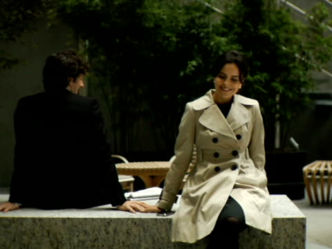 MS, Man and  woman flirting in lobby, New York City, New York, USA