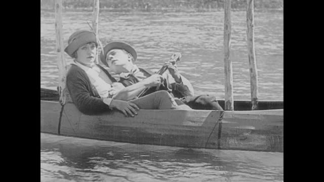1923 man (buster keaton) and woman (phyllis haver) float above the world - 1923 stock videos & royalty-free footage