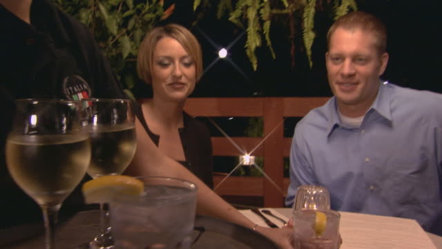 stockvideo's en b-roll-footage met man and woman having a quite dinner at restaurant - man met een groep vrouwen