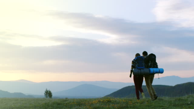 man and woman hiking on mountain - human relationship stock videos and b-roll footage