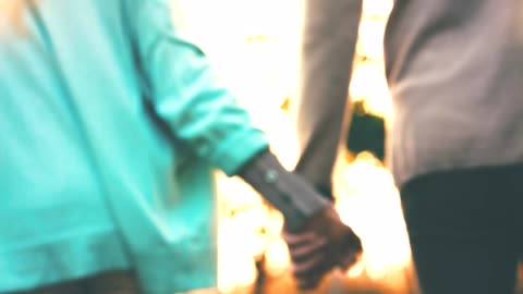 man and woman holding hands during sunny day - mid adult couple stock videos & royalty-free footage