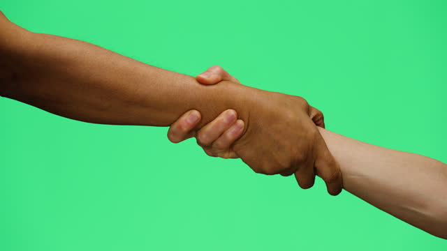 cu man and woman holding hands on green screen - human finger stock videos & royalty-free footage