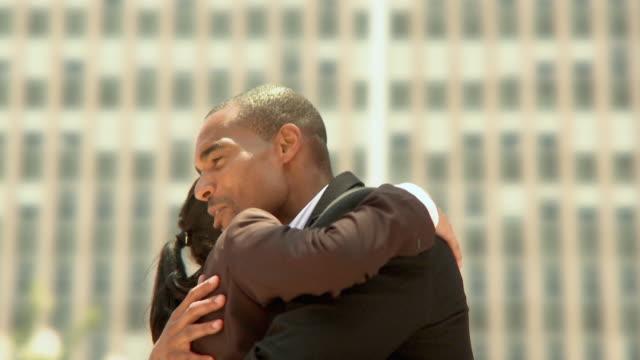 CU SHAKY Man and woman hugging outdoors, Jacksonville, Florida, USA