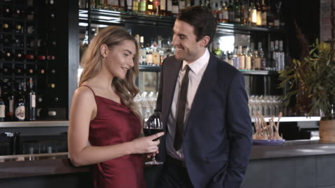 man and woman in a bar - flirting stock videos & royalty-free footage