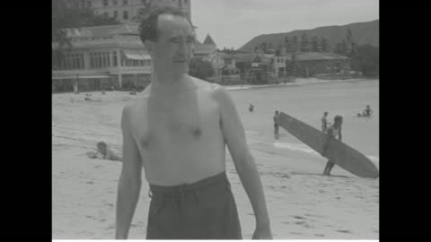 stockvideo's en b-roll-footage met man and woman in bathing suits walking across beach towards camera, ocean in background / same man walking across beach / same man eating while... - swimwear