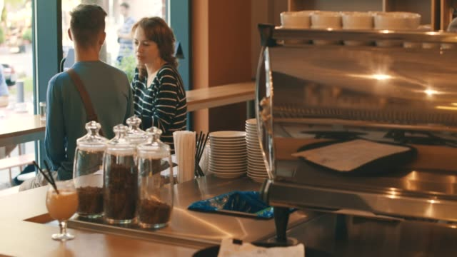 man and woman in cafe - coffee shop stock videos and b-roll footage