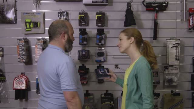 man and woman in shop - greater london stock videos & royalty-free footage