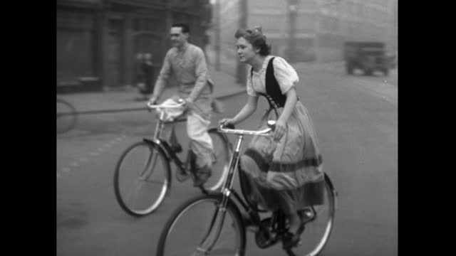 ws man and woman in traditional clothing cycle down street; 1952 - 1952 stock videos & royalty-free footage