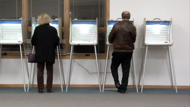 ms, man and woman in voting booths, rear view, ypsilanti, michigan, usa - ypsilanti stock videos & royalty-free footage