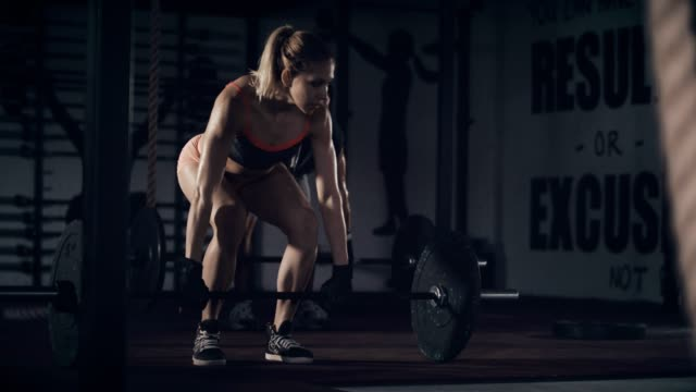 man and woman lifting weights in gym - strongwoman stock videos & royalty-free footage