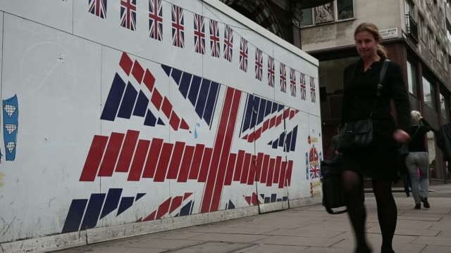 vidéos et rushes de a man and woman look at the window display of a prada spa store on old bond street in london uk on thursday april 3 various shots pedestrians walk... - burberry