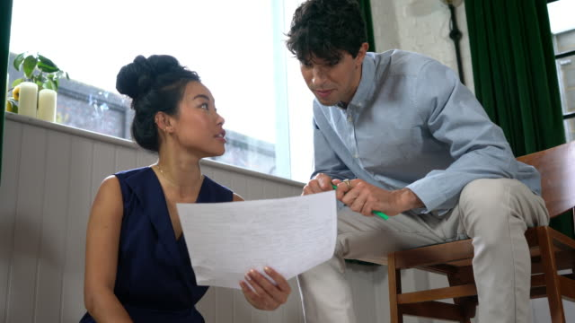 man and woman looking at paperwork - smart casual stock videos & royalty-free footage