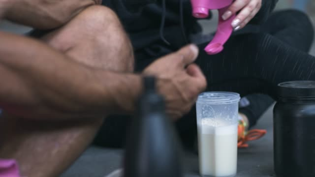 Man and Woman Making Protein Shake after Exercise