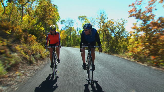 man and woman on bicycles - see other clips from this shoot 1174 stock videos and b-roll footage