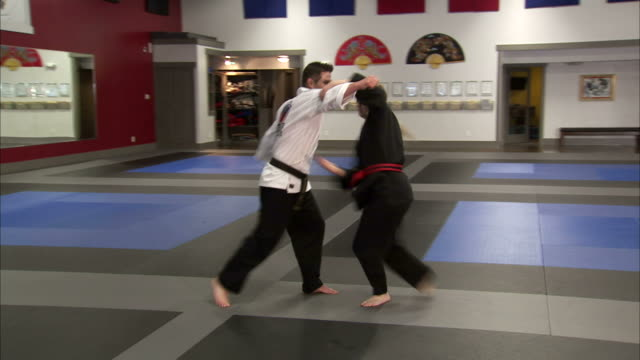 ws man and woman performing martial arts / springville, utah, usa - springville utah stock-videos und b-roll-filmmaterial