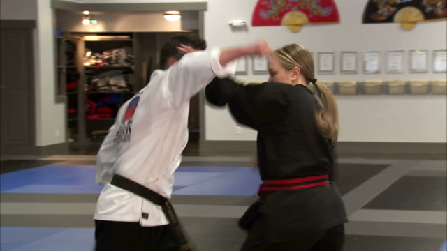 ms man and woman performing martial arts / springville, utah, usa - springville utah stock-videos und b-roll-filmmaterial