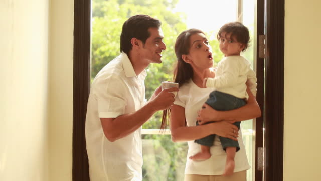 man and woman playing with their baby  - voice stock videos & royalty-free footage