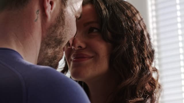man and woman sharing a moment of affection while standing face to face and looking into each others eyes - face to face stock videos & royalty-free footage