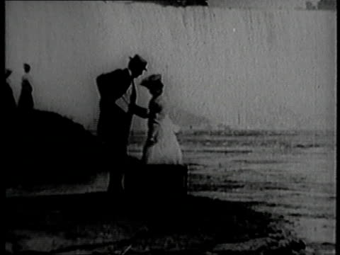 1900 ws man and woman sitting on a suitcase looking at niagara falls / new york, united states - 1899 stock videos & royalty-free footage