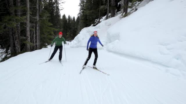 ms pov man and woman skiing in snow at mountain area / whistler, bc, canada - längd bildbanksvideor och videomaterial från bakom kulisserna