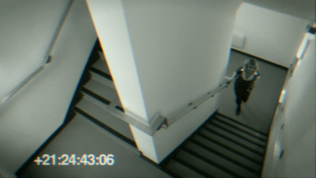 HS WS Man and woman sneaking up stairwell together during office party/ London, England