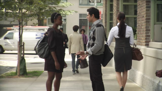 ms man and woman standing in middle of sidewalk talking, tribeca, new york, usa - three quarter length stock videos & royalty-free footage