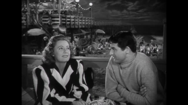 1941 Man (Cary Grant) and woman ( Irene Dunne) talk about their future while at the beach