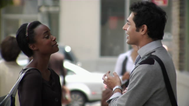 MS Man and woman talking on sidewalk, Tribeca, New York, USA