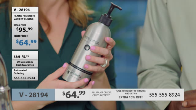 CU. Man and woman test eco-friendly body lotion in promotional infomercial.