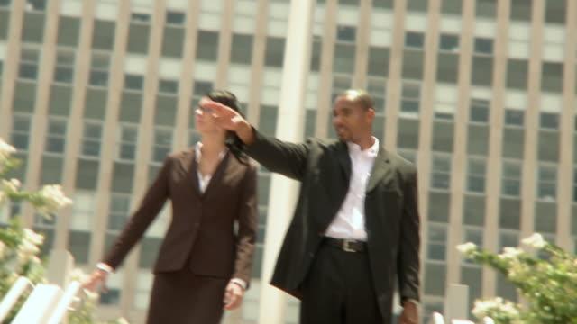 ms shaky man and woman walking down steps, smiling and talking, jacksonville, florida, usa - ゴーティー点の映像素材/bロール