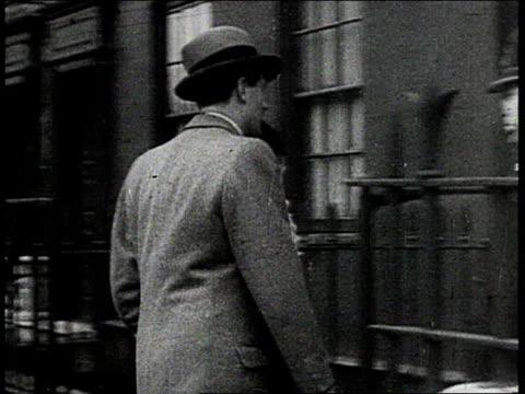 man and woman walking into a polling station / man dropping his ballot into a ballot box - voting ballot stock videos & royalty-free footage