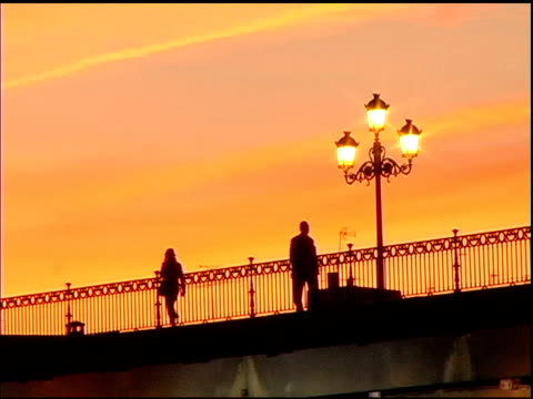 Man and Woman walking on Bridge in Seville
