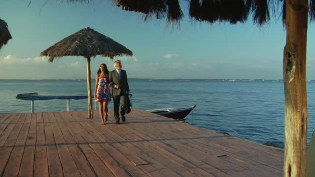 ws, man and woman walking on deck, manaus, brazil - handbag stock videos & royalty-free footage