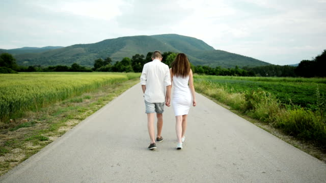 Man and woman walking together.