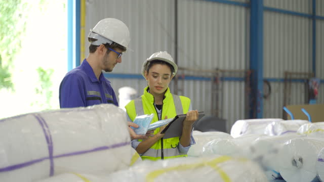 man and woman workers checking surgical masks package stock in warehouse - toxic waste stock videos & royalty-free footage