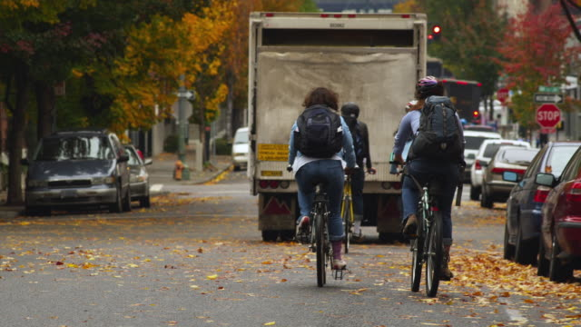 ws pov man and women riding bicycle in pearl district / portland, oregon, usa - portland oregon bike stock videos & royalty-free footage