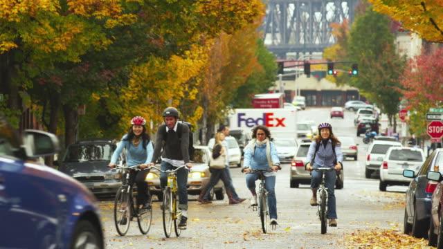 ws pan man and women riding bicycle in pearl district / portland, oregon, usa - portland oregon bike stock videos & royalty-free footage