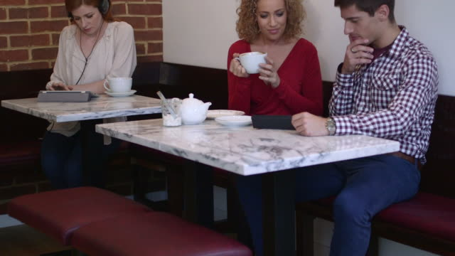 Man and women sitting in cafe