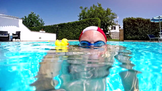 man and yellow ducks - swimming goggles stock videos & royalty-free footage
