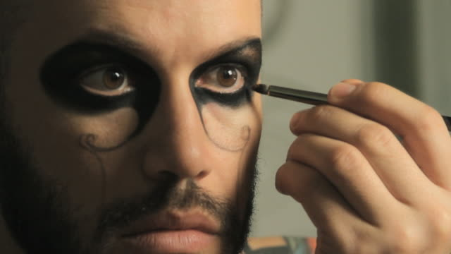 cu man applying gold make-up around his eye / miami, florida, usa - stage make up stock videos and b-roll footage