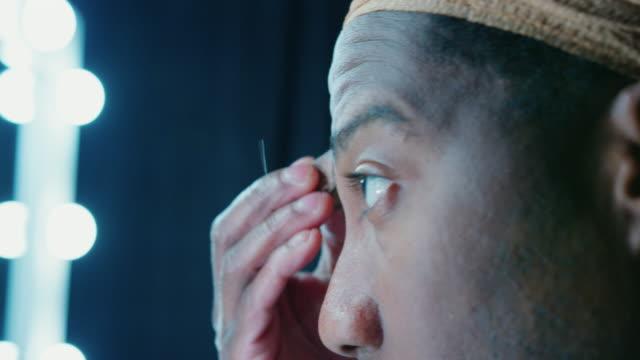 man applying make-up - backstage stock videos & royalty-free footage