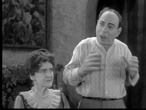 1929 b/w ms man arguing with his mother-in-law/ usa/ audio - mother in law stock videos & royalty-free footage