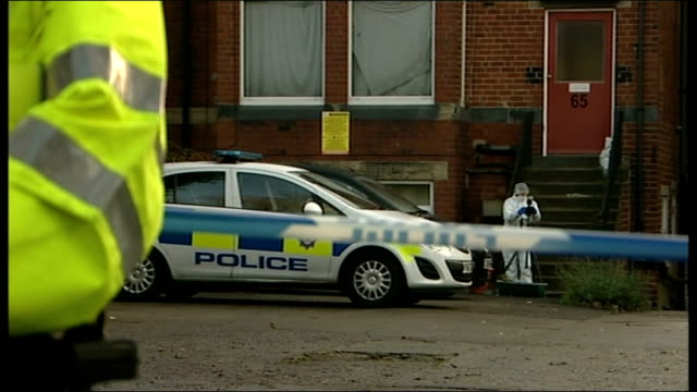 Man arrested after police woman shot in Leeds ENGLAND West Yorkshire Leeds EXT Police vehciles parked in car park Forensic officer taking photographs...