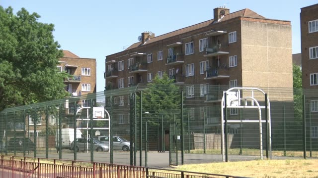 Man arrested after teenage girl fatally stabbed in Camberwell ENGLAND London Camberwell EXT GVs blocks of council flats Police van parked in road...