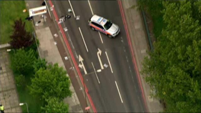 man arrested for alleged threat to kill a west midlands police officer lib woolwich police at scene where drummer lee rigby was murdered - lee rigby stock videos & royalty-free footage