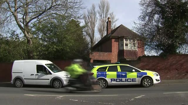 man arrested on suspicion of murder of three men in their 80s in exeter; england: devon: exeter: ext house with boarded-up windows traffic along road... - exeter england stock videos & royalty-free footage