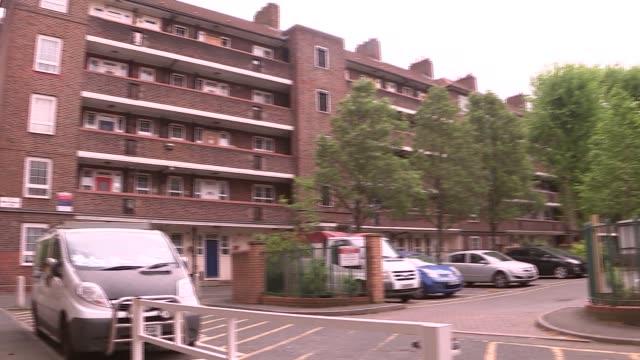Man arrested on suspicion of murdering woman in Whitechapel ENGLAND London Whitechapel EXT Various shots of housing estate
