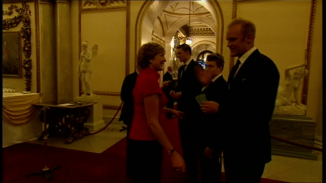 man arrested over olympic medal thefts lib / buckingham palace partridge at royal reception for olympic athletes queen elizabeth ii chatting to guests - バッキンガムシャー点の映像素材/bロール