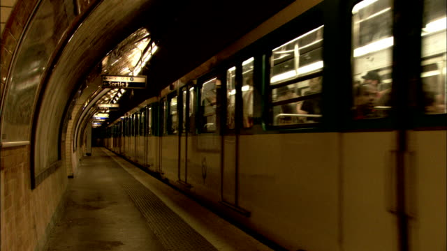 A man arrives on the platform of a Paris Metro station just after the train leaves. Available in HD.